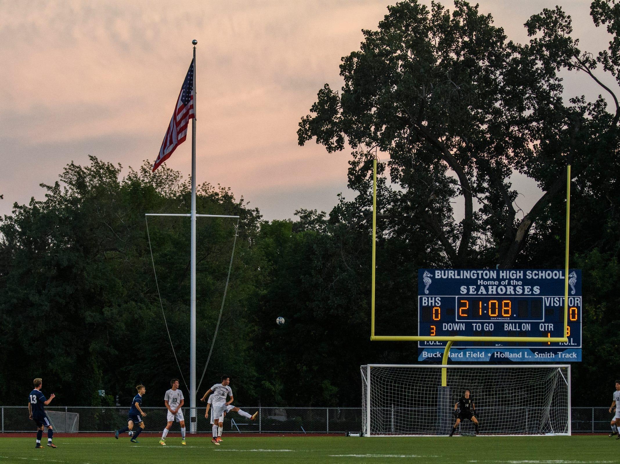 Burlington's Sam Hogg (13) kicks the ball towards the net during the boys soccer game between Stowe and Burlington at Buck Hard field on Wednesday night September 5, 2018 in Burlington.