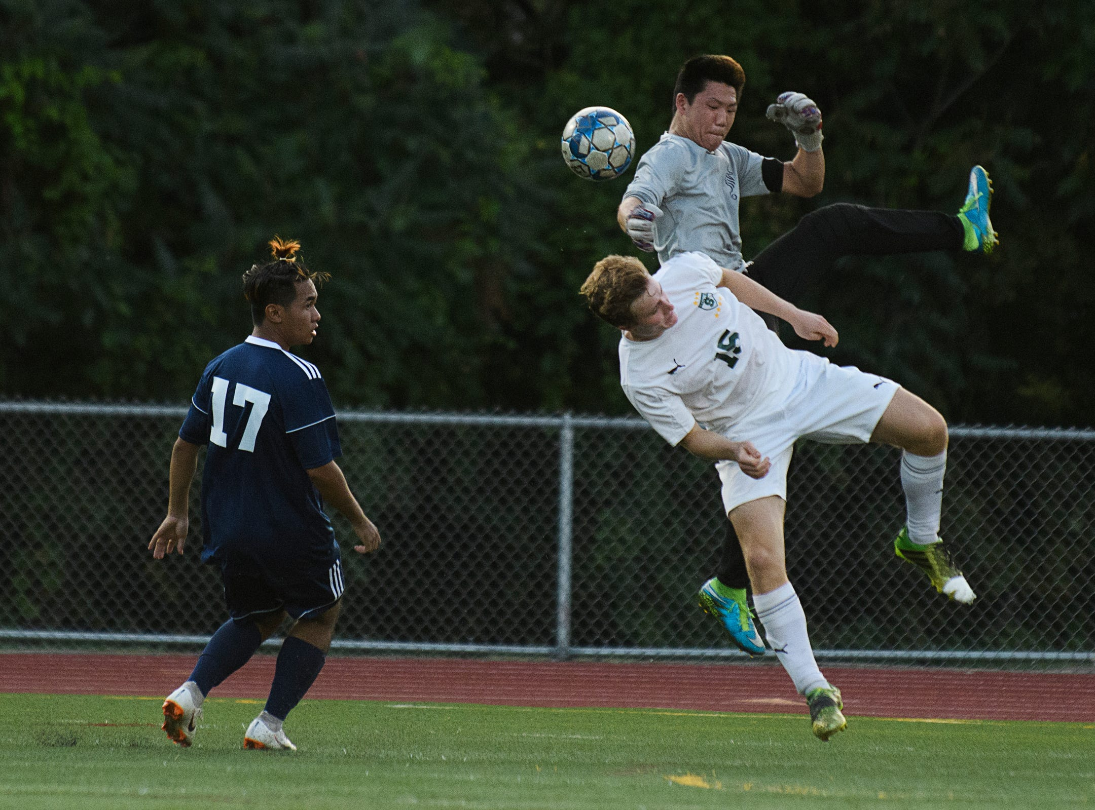 Stowe's Jace Boerger (15) crashes into Burlington goalie Kiran Ghimire during the boys soccer game between Stowe and Burlington at Buck Hard field on Wednesday night September 5, 2018 in Burlington.