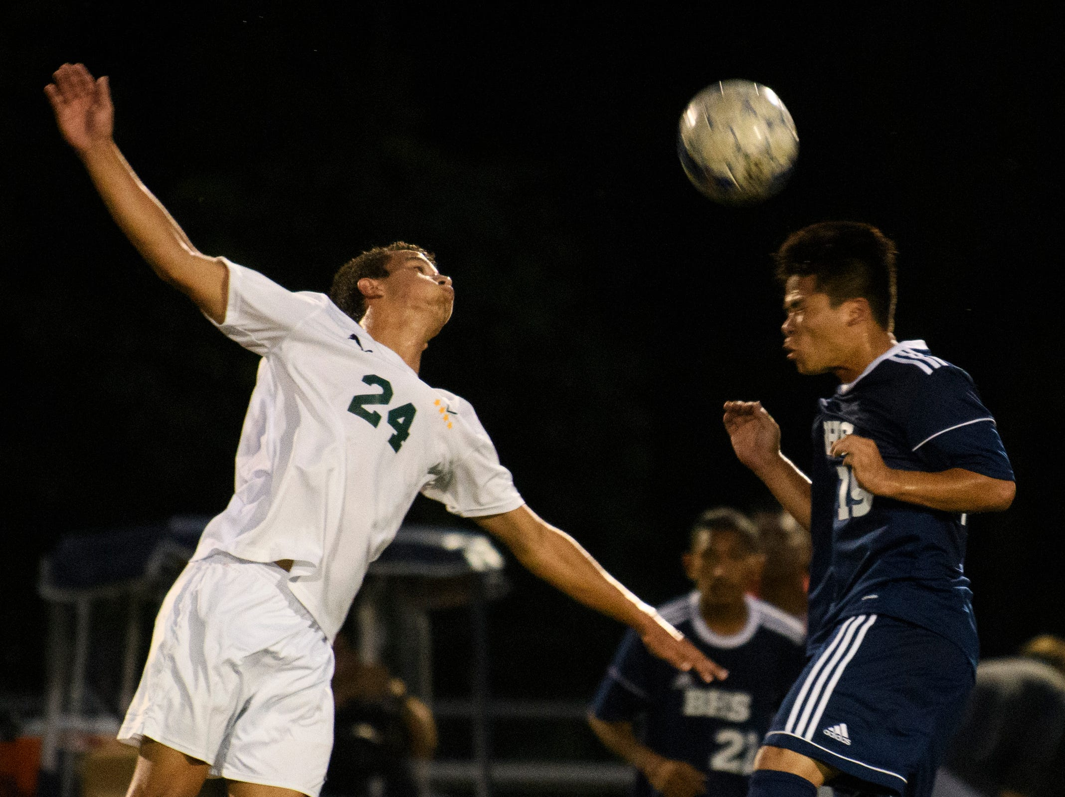 Burlington's Roman Magar (19) leaps to head the ball over Stowe's Rai Bleda-Vilalta (24) during the boys soccer game between Stowe and Burlington at Buck Hard field on Wednesday night September 5, 2018 in Burlington.