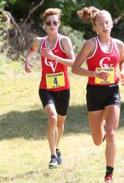Ella Whitman, right, and Alice Larson are the leading runners for the CVU girls cross-country team, which is looking for its 10th straight Division I title later this fall.