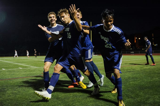 Burlington celebrates a goal during the boys soccer game between Stowe and Burlington at Buck Hard field on Wednesday night September 5, 2018 in Burlington.