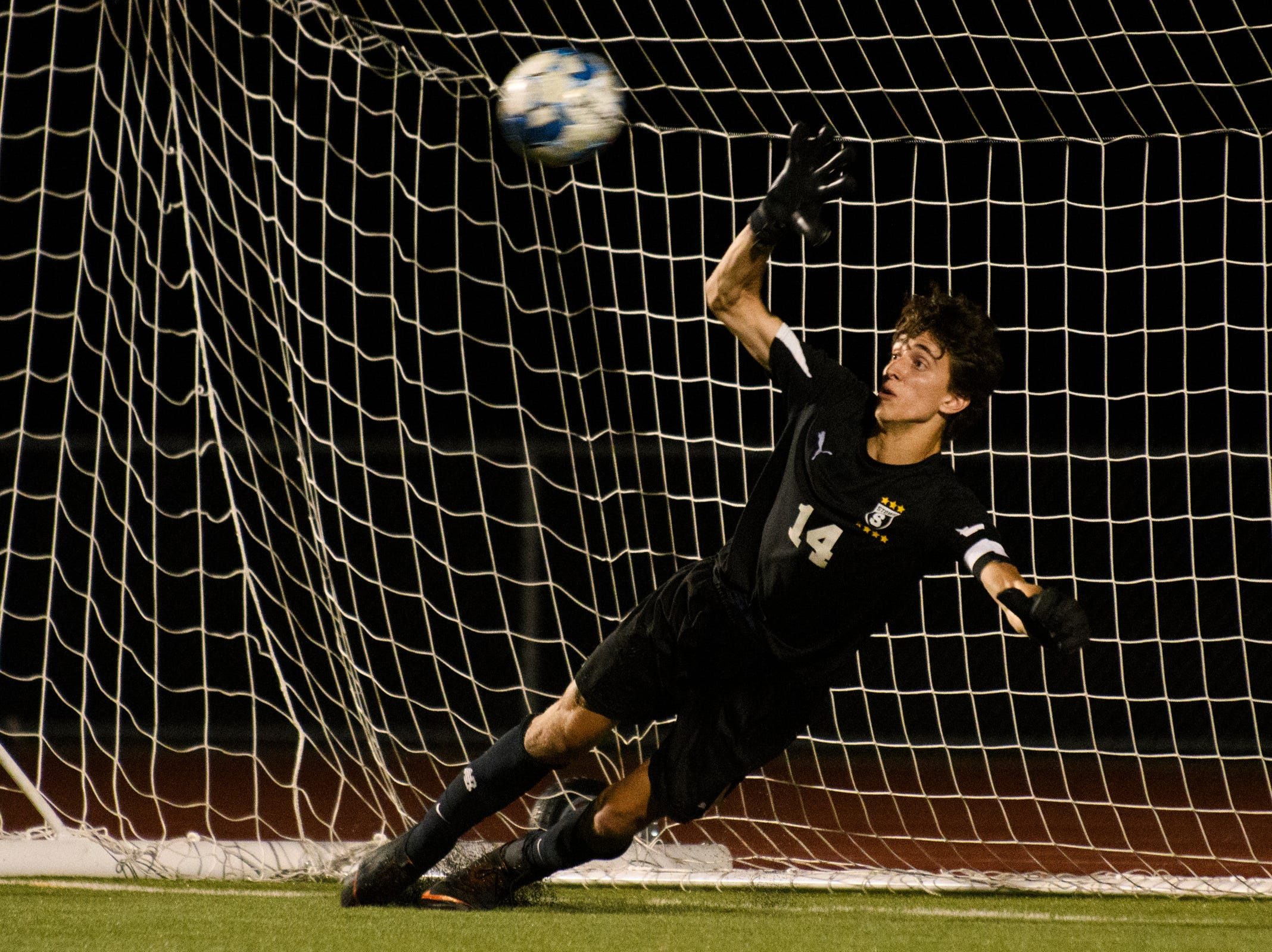 Stowe goalie tries to make a save on the penalty kick during the boys soccer game between Stowe and Burlington at Buck Hard field on Wednesday night September 5, 2018 in Burlington.