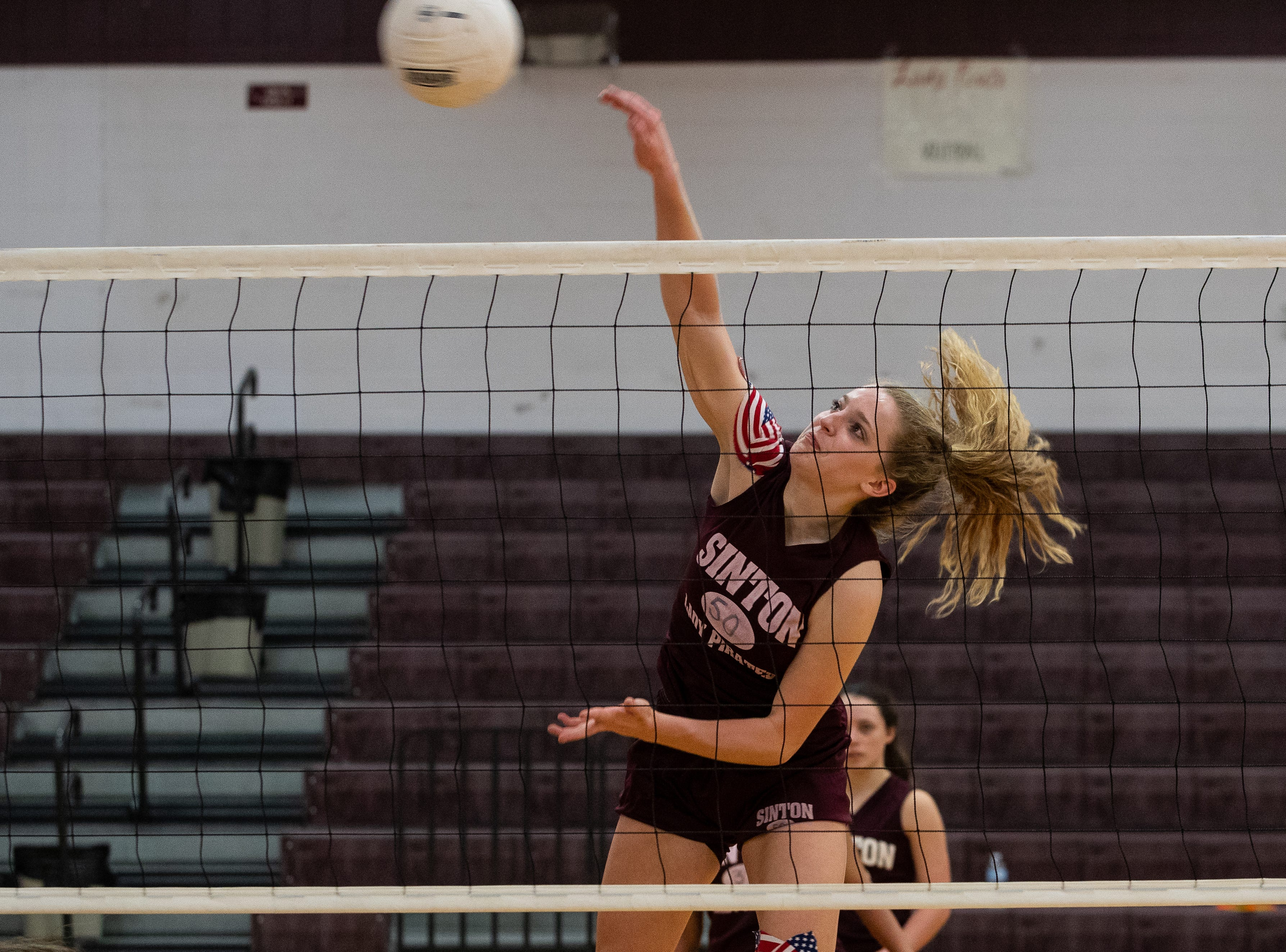 Sinton's Lela Thomas spikes the ball during practice at Sinton High school on Wednesday, Sept. 5, 2018. Lela Thomas plays with her cousins Stella, Emma and Anna Thomas.
