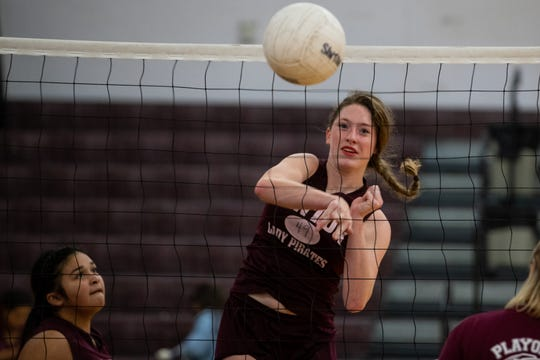 Sinton's Emma Thomas spikes the ball during practice at Sinton High school on Wednesday, Sept. 5, 2018. Emma Thomas plays with her two sisters Anna and Stella Thomas and cousin Lela Thomas.