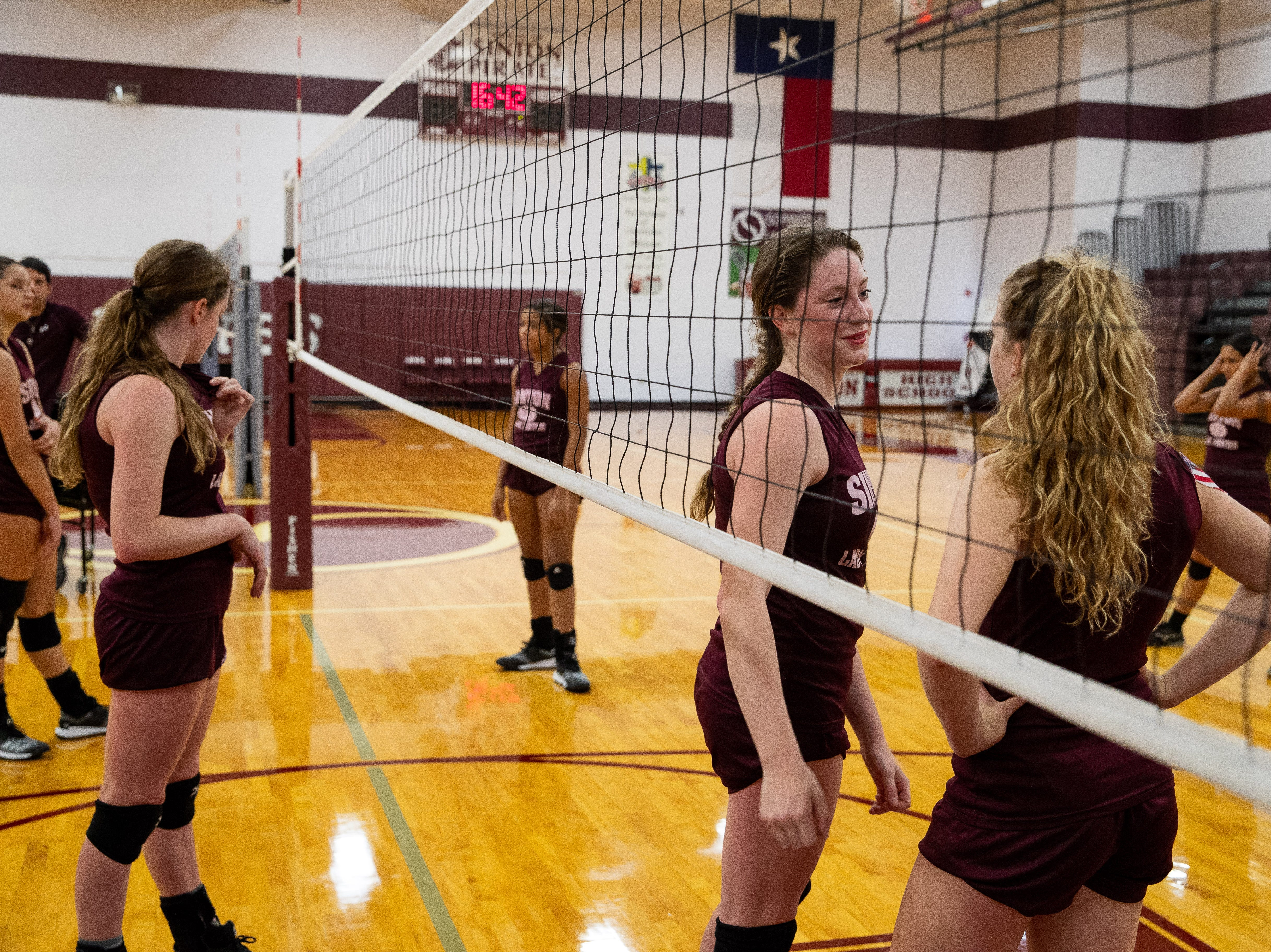 Emma Thomas and her cousin Lela Thomas talk during practice at Sinton High school on Wednesday, Sept. 5, 2018