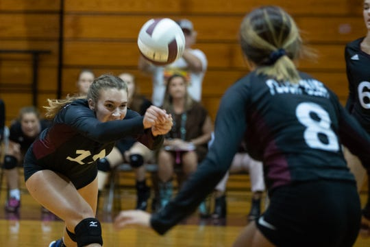 Flour Bluff's Kylee McCarrell bumps the ball during the first set against Gregory-Portland at Flour Buff on Friday, Sept. 7, 2018.