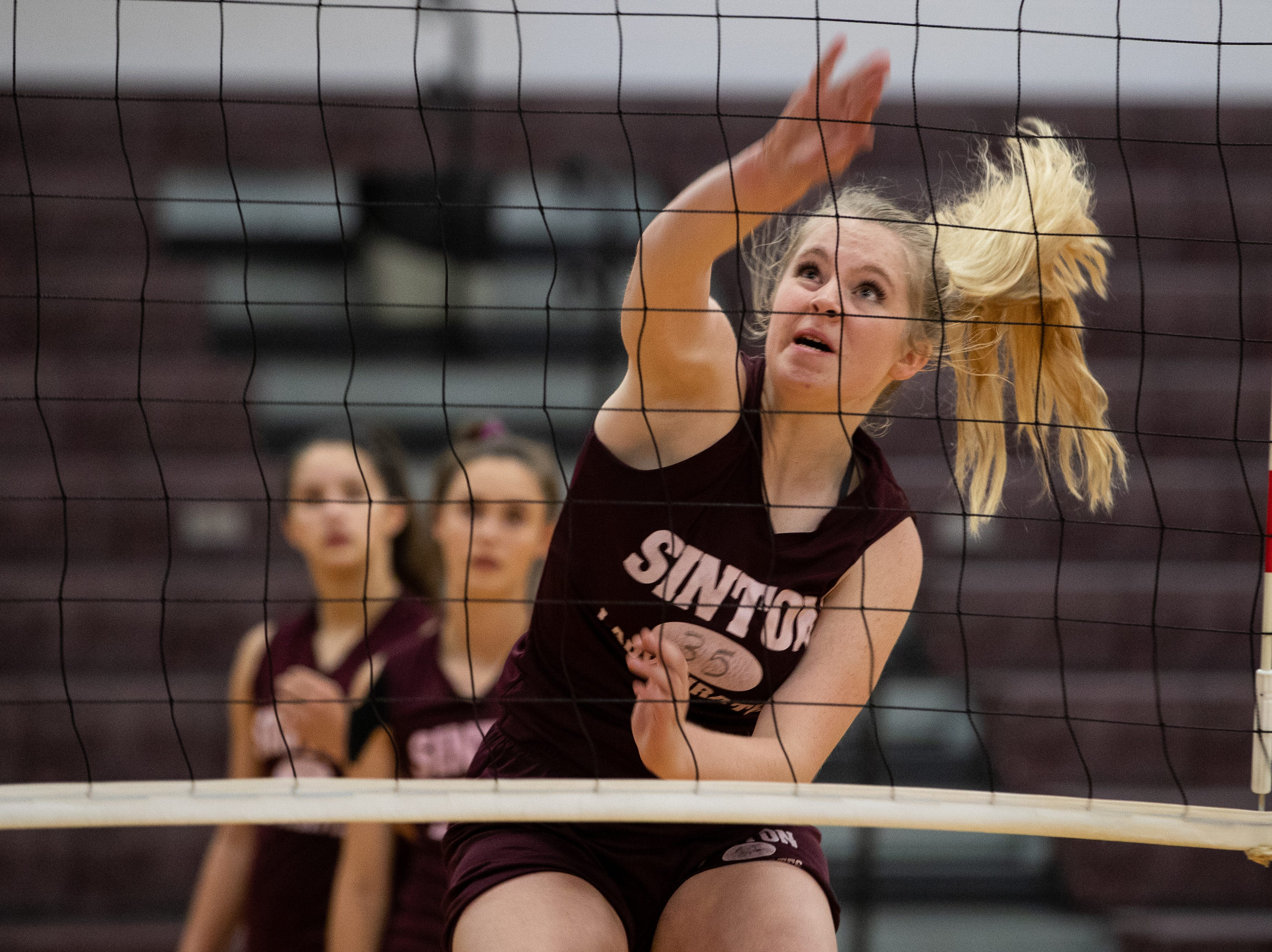 Sinton's Anna Thomas spikes the ball during practice at Sinton High school on Wednesday, Sept. 5, 2018. Anna Thomas plays with her two sisters Stella and Emma Thomas and cousin Lela Thomas.