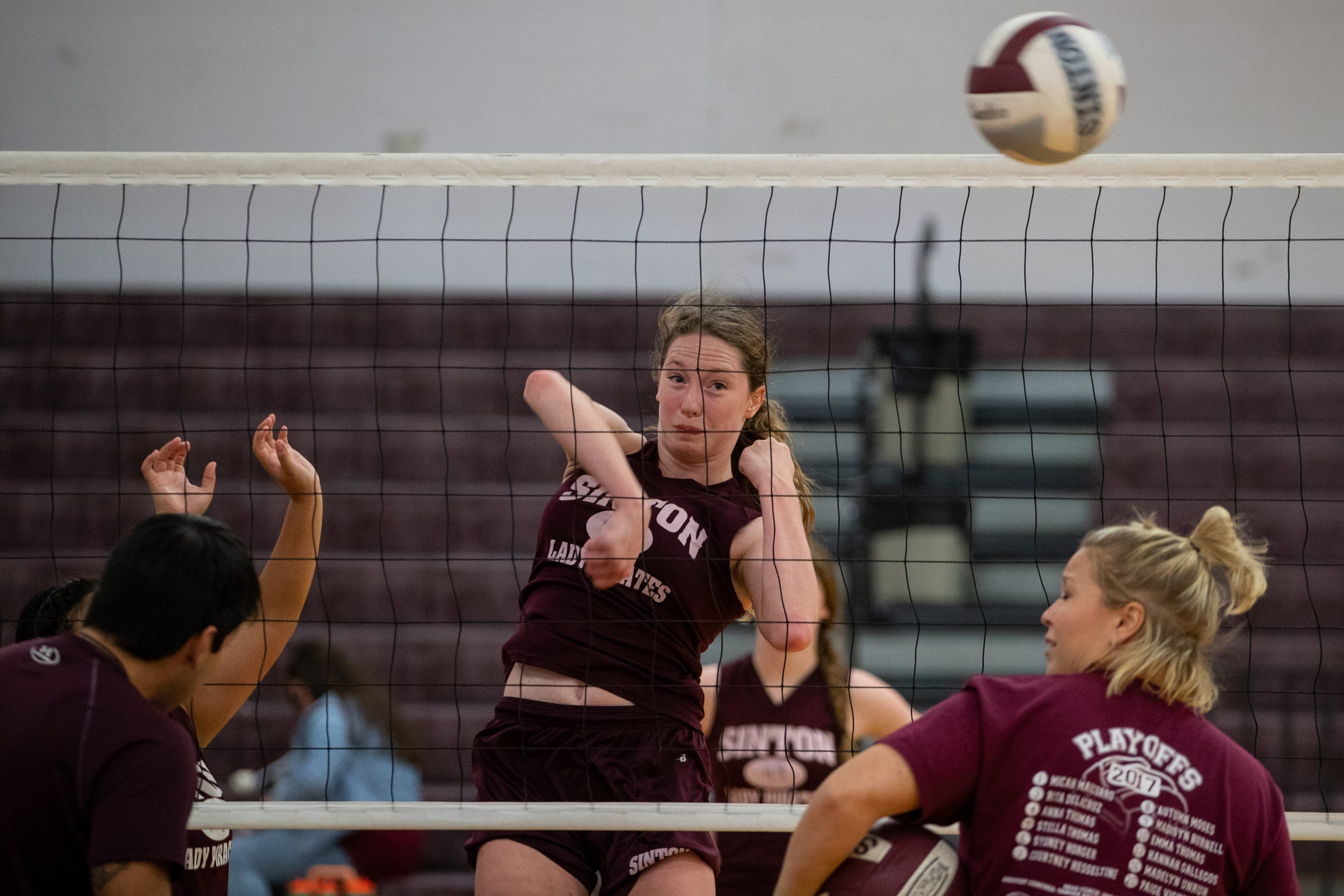 Sinton's Stella Thomas spikes the ball during practice at Sinton High school on Wednesday, Sept. 5, 2018. Stella Thomas plays with her two sisters Anna and Emma Thomas and cousin Lela Thomas.