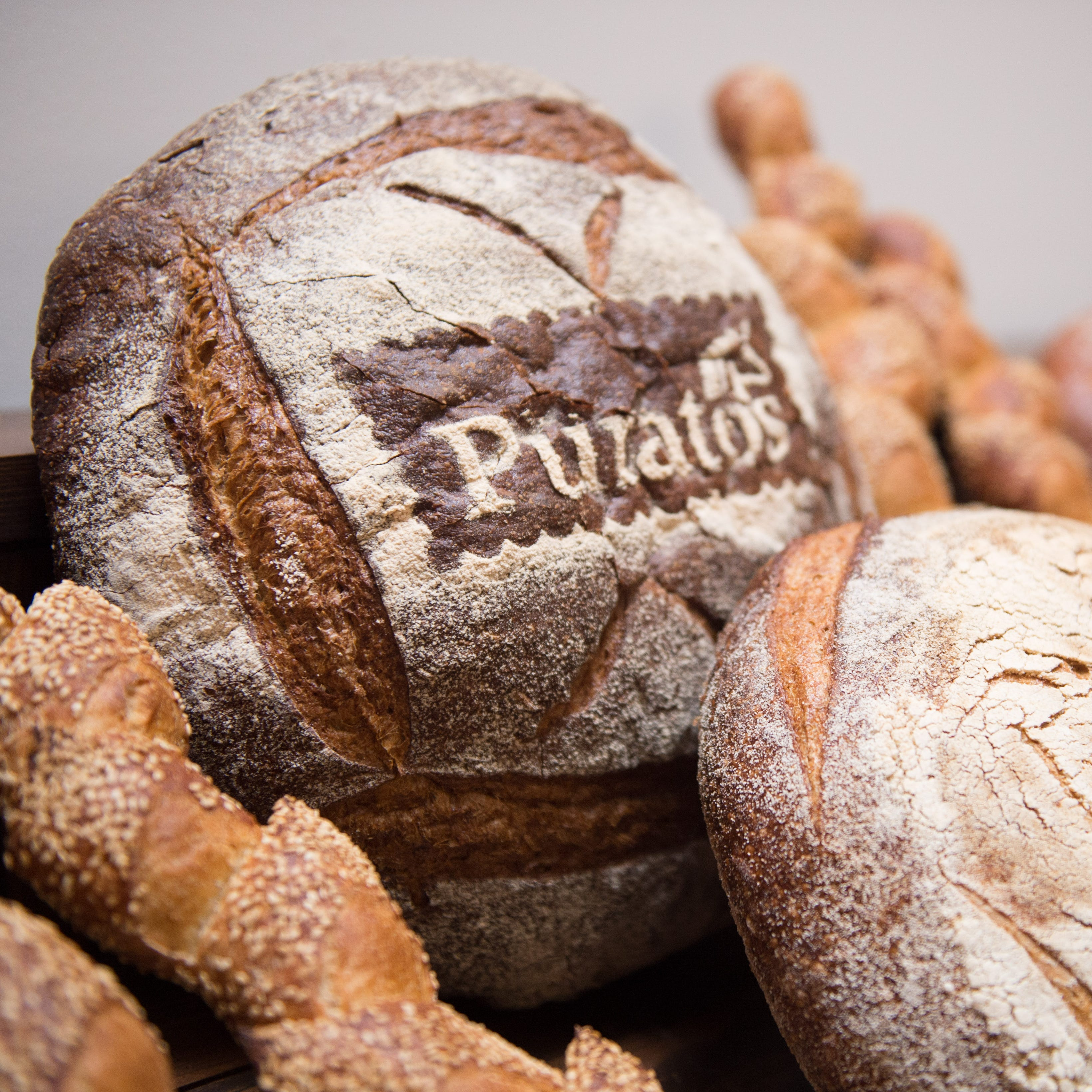 Old world style bread products sit on display during the grand opening for a new research and development center at Puratos national headquarters in Pennsauken, N.J. on Friday, Sept. 7, 2018.