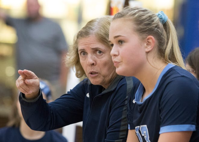 Adena's Laura Smith instructs a Warriors' player during Thursday's match at Southeastern High School. The Warriors lost the match, but Smith recently earned her 700th win, a feat that only two others have ever done and no high school volleyball coach has ever done at just one school.