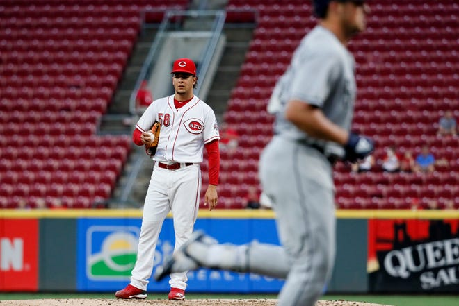 Cincinnati Reds starting pitcher Luis Castillo (58) stands on the mound as San Diego Padres' Hunter Renfroe runs the bases on a solo home run during the fourth inning of a baseball game, Thursday, Sept. 6, 2018, in Cincinnati.