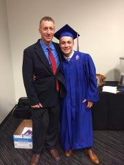 Shawn Garnett with son Tommy at Tommy's 2018 graduation from Conner High School (via Garnett's Facebook).