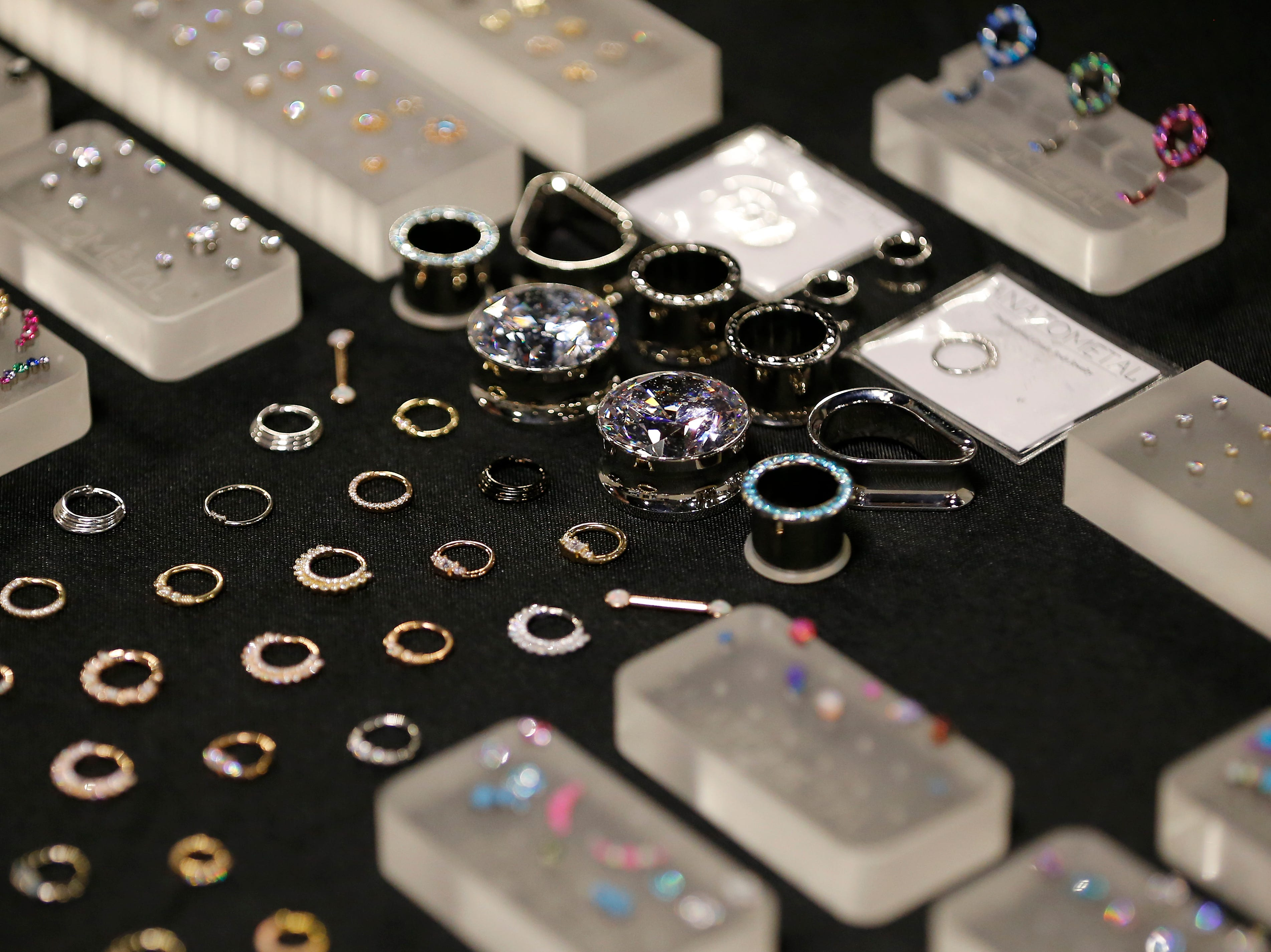 Body jewelry is displayed during the Greater Cincinnati Tattoo Arts Convention at the Northern Kentucky Convention Center in Covington, Ky., on Friday, Sept. 7, 2018.