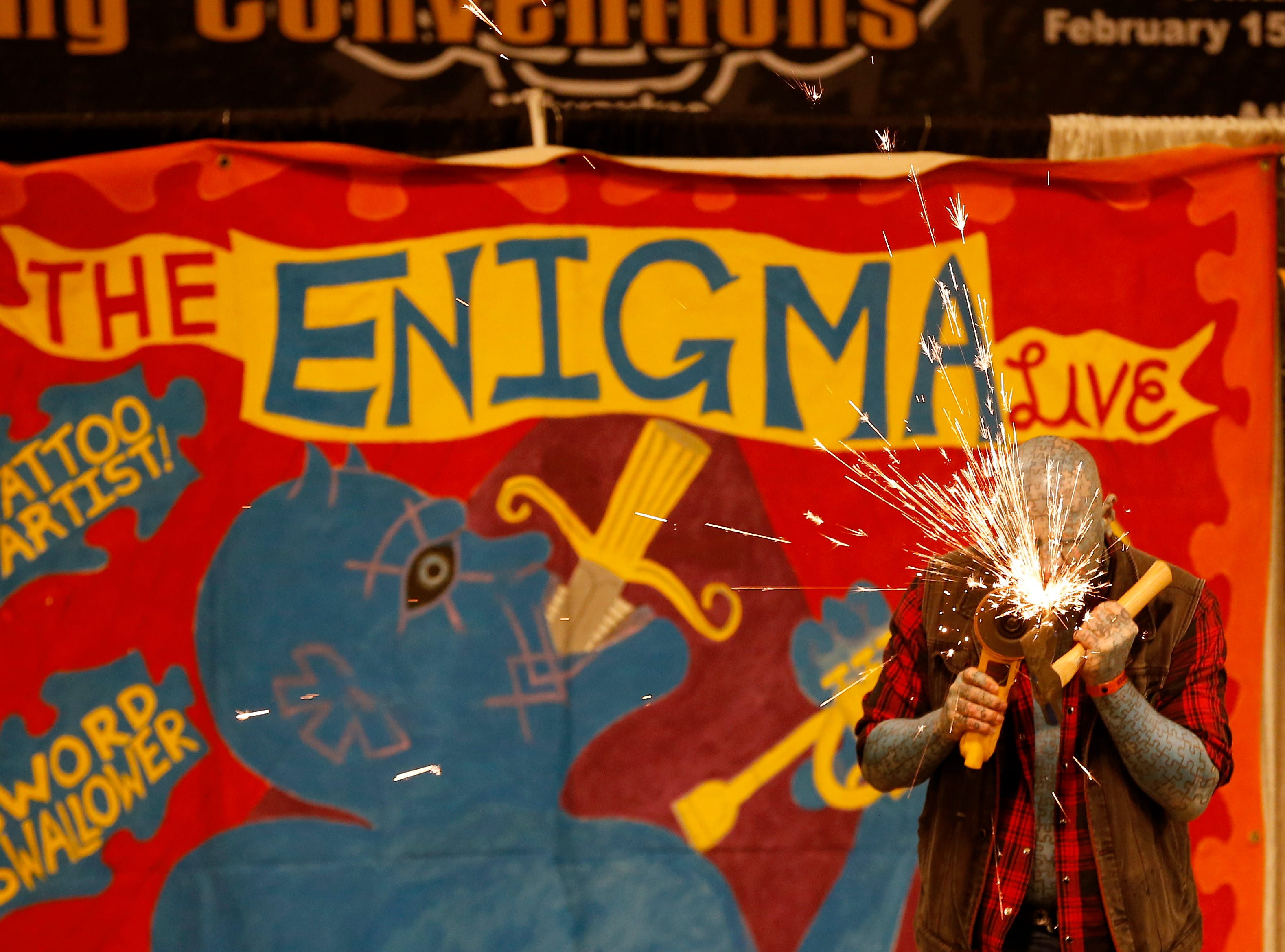 The Enigma performs during the Greater Cincinnati Tattoo Arts Convention at the Northern Kentucky Convention Center in Covington, Ky., on Friday, Sept. 7, 2018.