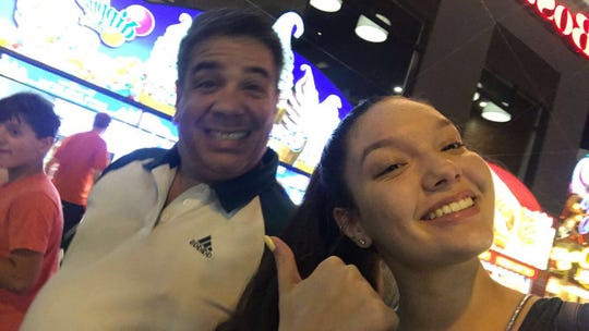 Luis Felipe Calderón was one of the three people killed by a shooter in a rampage in Fountain Square on Sept. 6. Here he is with his daughter, Natalia.