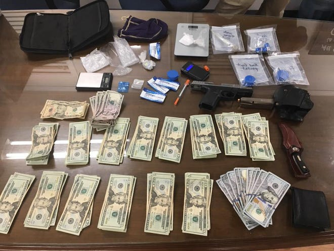 """The Humphreys County Sheriff's Office posted this photo on Facebook with the caption, """"Detectives had a nice bust tonight. We have had several good ones lately. Tonight was just guns, drugs, and money. Our deputies are not kneeling for the national anthem, they are locking up drug dealers, even without a Nike sponsorship."""""""