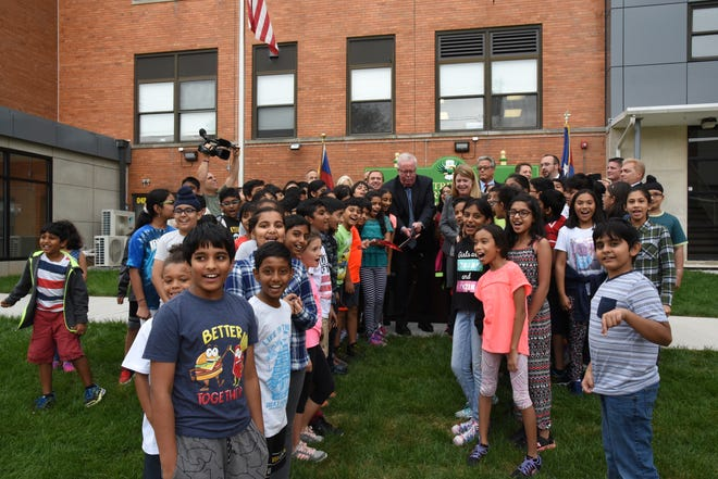 The fully renovated $8 million Oak Tree Road Elementary School No. 29 opened on Sept. 5 in Woodbridge. Mayor John McCormac is pictured cutting a ceremonial ribbon on Sept. 7 with several students, as well as dignitaries.
