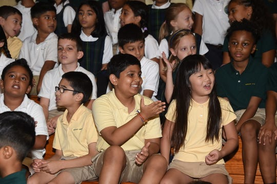 Lower School students are all smiles at Convocation.