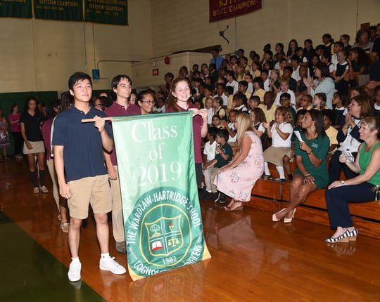 Ray Huang of Edison and Alexandra Vargas of Dunellen lead the Class of 2019 into the Convocation ceremony.