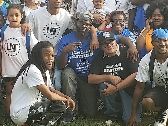 Carteret Republican mayoral candidate Fred Gattuso is pictured with minority supporters at a Sept. 1 event sponsored by UNT Entertainment in the borough's Chrome Park.