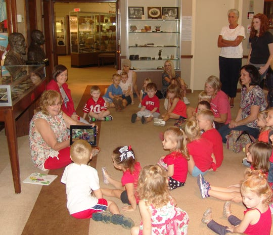 Young participants learn about the color red at the Johnson-Humrickhouse Museum.