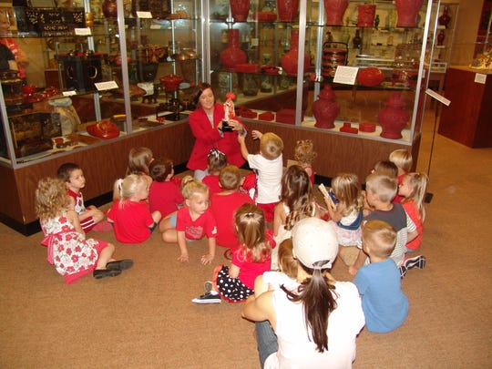 Director Jennifer Bush helps youngsters explore the color red and the Asian Gallery at the Johnson-Humrickhouse Museum.