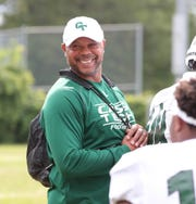 Cass Tech coach Thomas Wilcher smiles on the sidelines during action against Henry Ford on Friday, Sept. 7, 2018 at Henry Ford in Detroit.