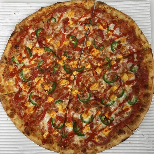 Major Tomato in Allen Park serves a high-quality thin crust pizza made with fresh ingredients.