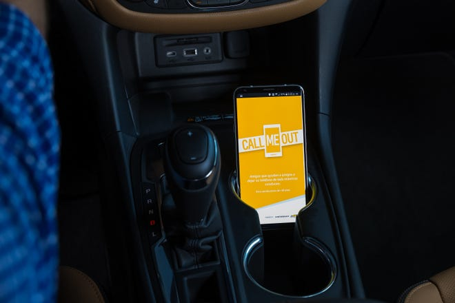 Chevrolet launches a new smartphone app, Call Me Out, to help remind drivers to keep their hands off their phones and eyes on the road through audible messages from friends and family. (Photo by Rob Widdis for Chevrolet)