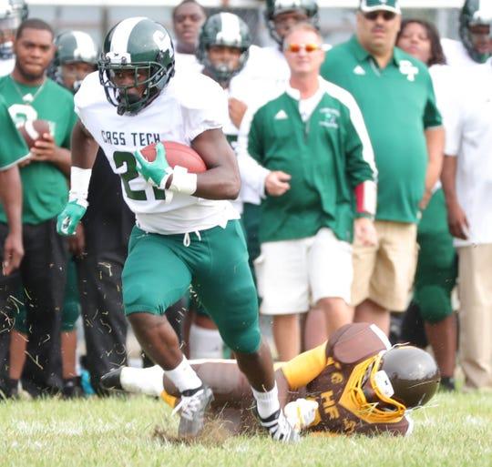 Cass Tech high schools Lew Nichols runs the ball against Henry Ford high school Friday, September 7, 2018 at Henry Ford high school in Detroit.