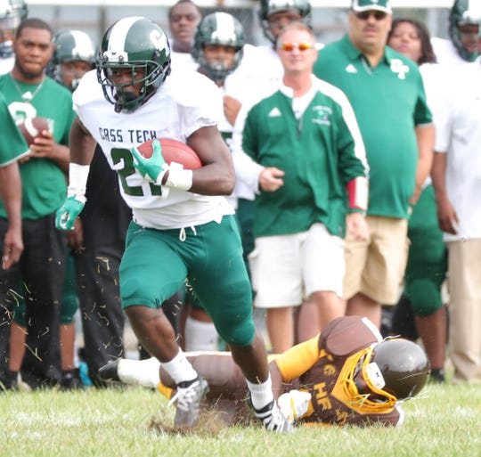Cass Tech high schools Lew Nichols runs the ball against Henry Ford high school Friday, September 7, 2018 at Henry Ford high school in Detroit.