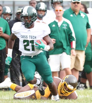 Cass Tech's Lew Nichols runs the ball against Henry Ford on Friday, Sept. 7, 2018 at Henry Ford in Detroit.