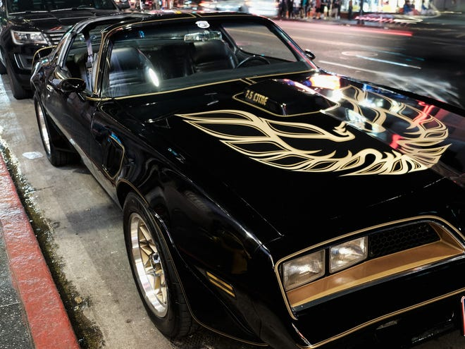 "The Pontiac Firebird Trans Am from Burt Reynold's film ""Smokey and the Bandit"" is seen in front of Burt Reynold's star on the Hollywood Walk of Fame on Sept. 6, 2018, in Los Angeles."
