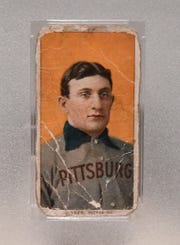 The rare Honus Wagner T206 white border baseball card from 1909-1911.