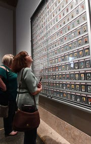 Deanna Beaton and Wendy Akers marvel at the complete T206 white border baseball card set from 1909-1911.