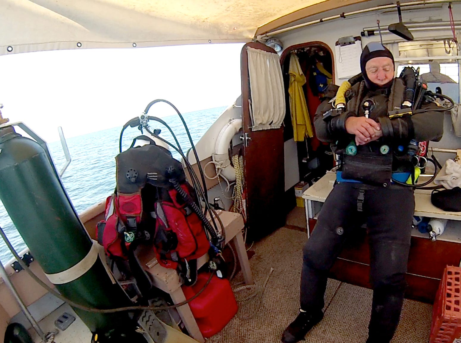 Technical diver Ken Merryman prepares his rebreather equipment for a deep dive. He and Cris Kohl became the first divers to visit the wreck of the J.H. Jones.