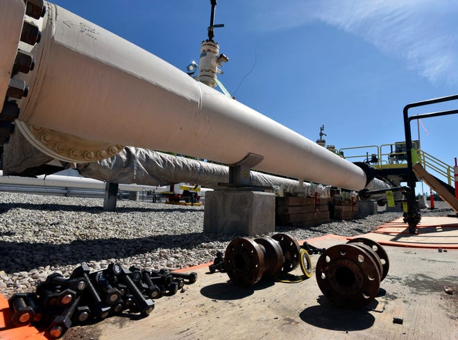 In this 2017 file photo, fresh nuts, bolts and fittings are ready to be added to the east leg of the pipeline near St. Ignace, Mich., as Canadian oil transport company Enbridge prepares to test the east and west sides of the Line 5 pipeline under the Straits of Mackinac.