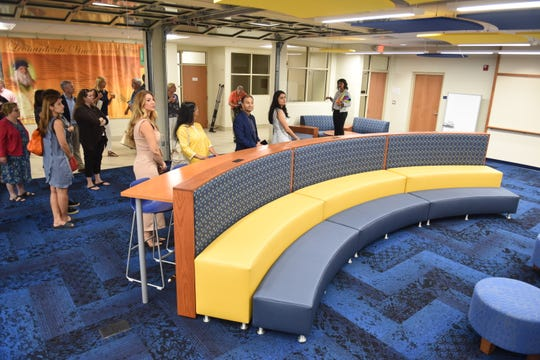 Tina Mangalick (right), director, major gifts, Detroit Country Day,  speaks during a tour of the Creative Commons media area as the school celebrated the  $14 million dollar expansion and renovation of DCDS middle school in Beverly Hills  on Friday, September 7, 2018.