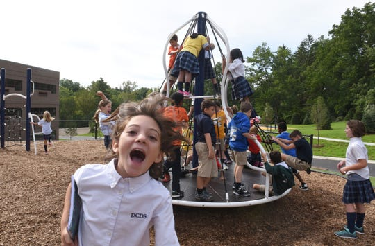Detroit Country Day Middle School students enjoy the new playscape during a tour of the $14 million dollar expansion and renovation of DCDS middle school project at the Beverly Hills campus on Friday, September 7, 2018.