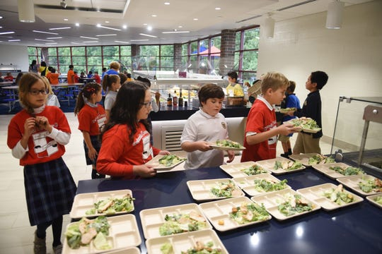 Detroit Country Day Middle School students enjoy their lunch in the new cafeteria during a tour of the $14 million dollar expansion and renovation of DCDS middle school at the Beverly Hills campus on Friday, September 7, 2018.