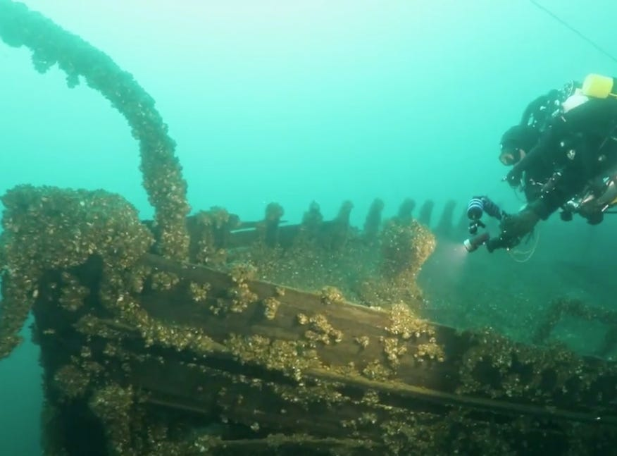 A diver explores the wreck of the J.H. Jones, resting under 200 feet of water. Only one body — that of a young businessman passenger — was found, on Christian Island across the bay.
