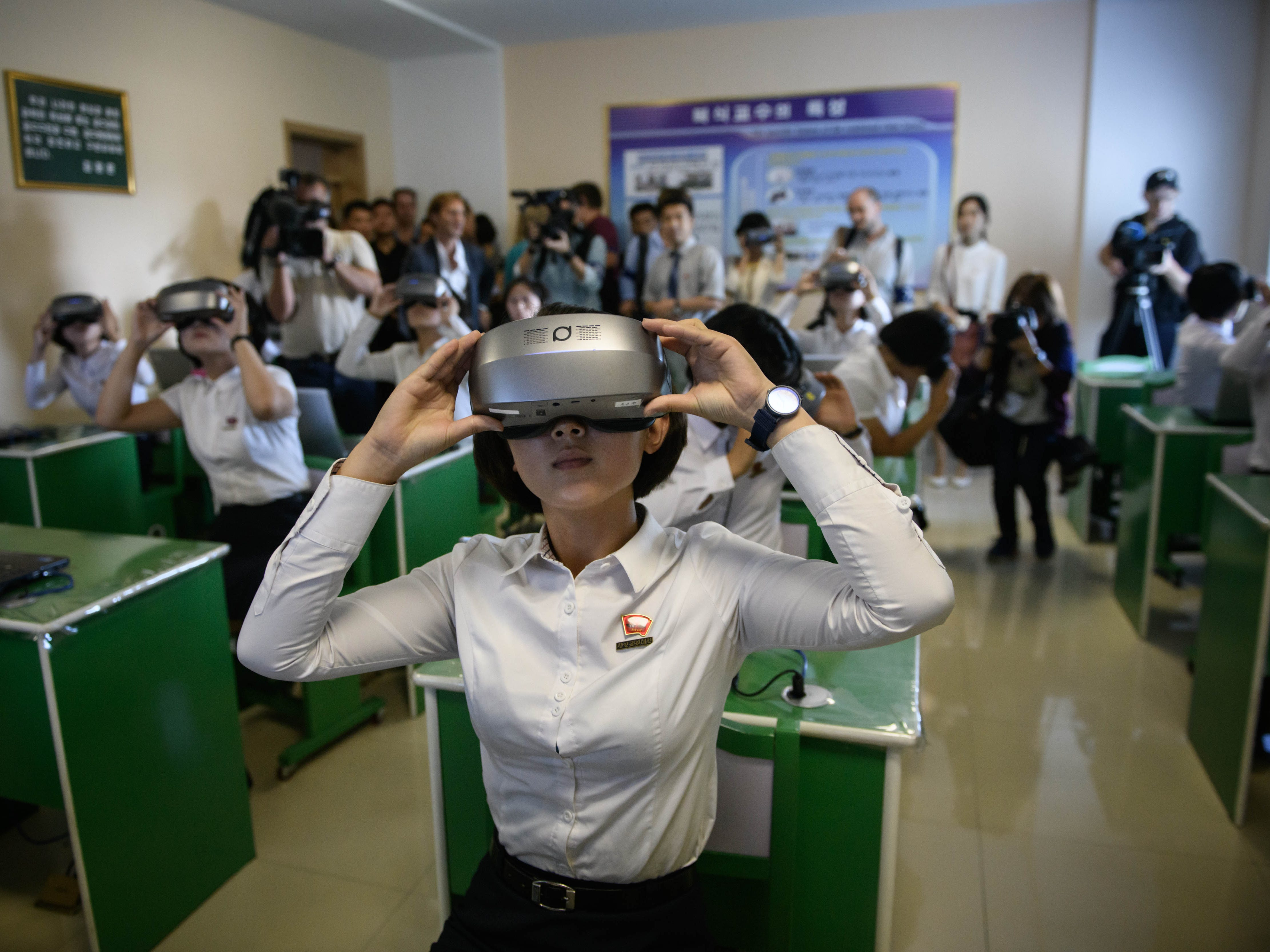 Students look through virtual-reality goggles during a tour for visiting foreign media to a teacher training college in Pyongyang on Sept. 7, 2018. North Korea is preparing to mark the 70th anniversary of its founding on Sept. 9.