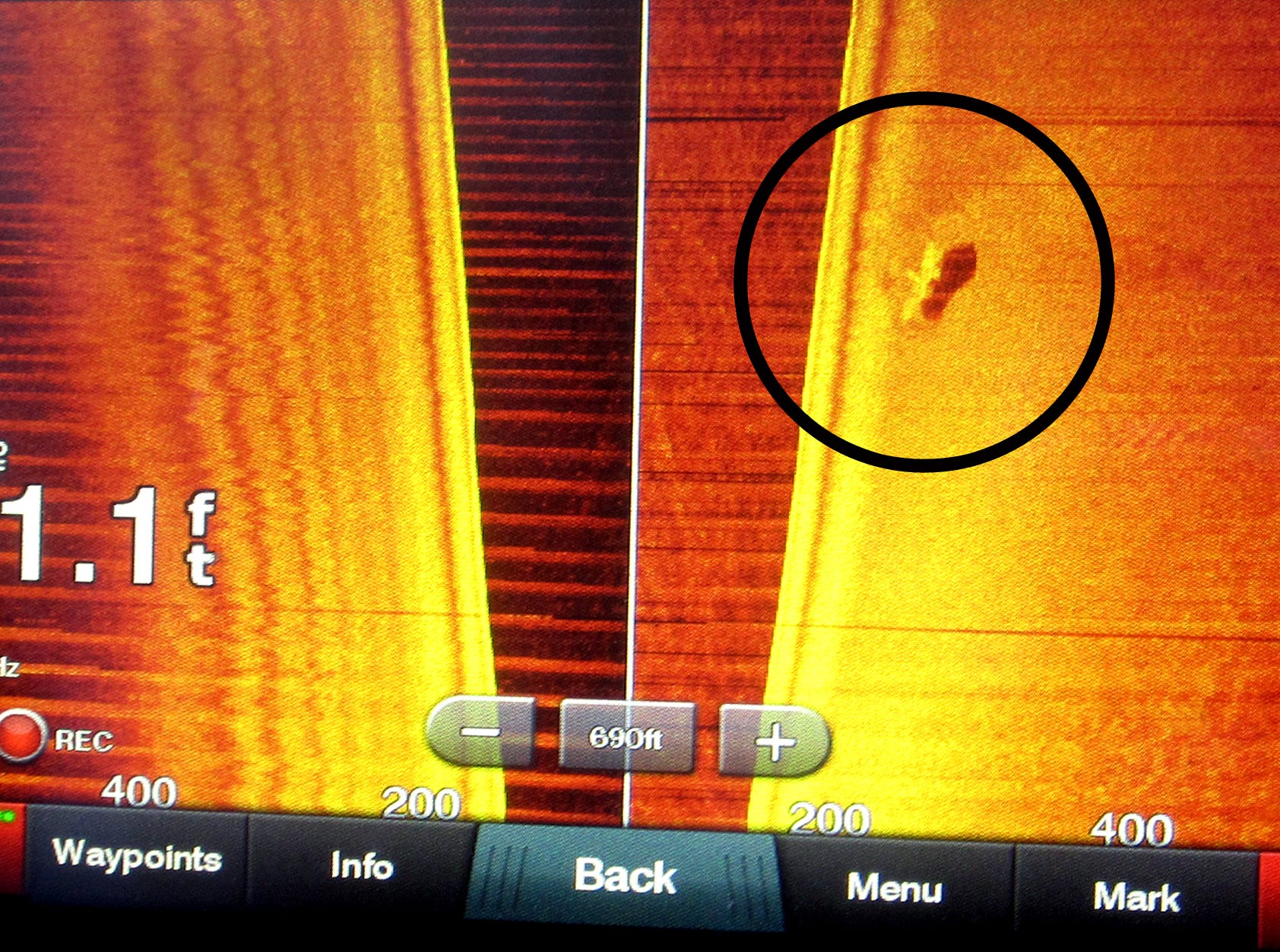 The side scan sonar screen revealed a shipwreck in deep water after only two hours of searching.