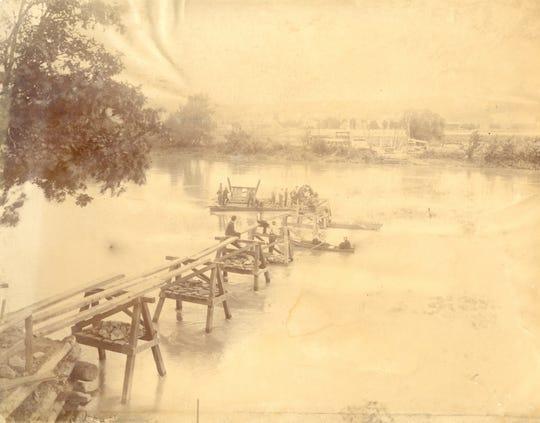 The Rorick's Glen bridge under construction on the Chemung River.