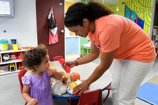 Alicia McDowell with One Main Financial plays with Anna Lee Felton, 2 years-old, at the Ark Crisis Child Care for the United Way Day of Caring, where hundreds of volunteers spend the day working at local nonprofit agencies to kick off the annual United Way fall campaign Friday, September 7, 2018.