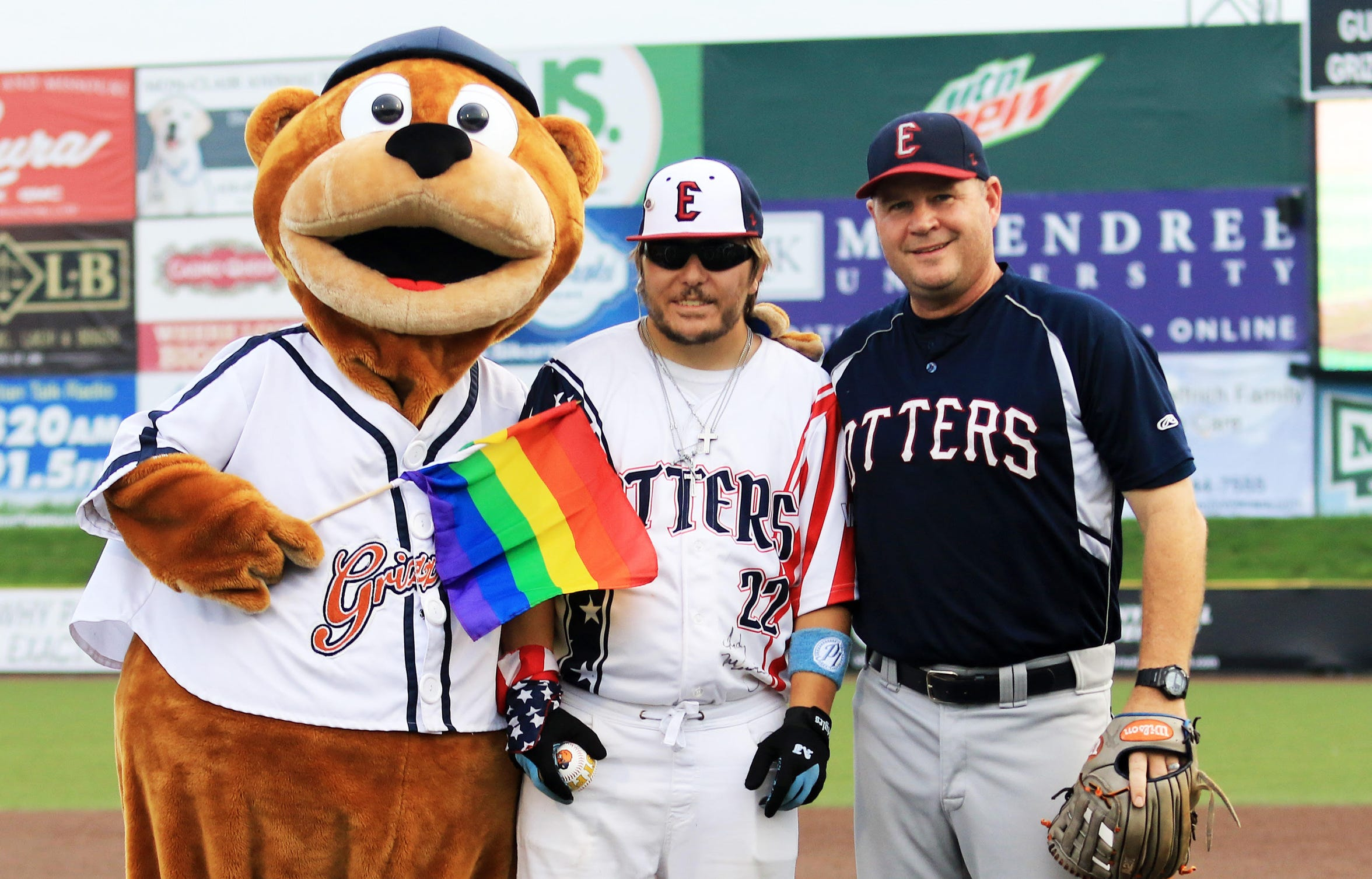 Evansville Otters' superfan Nick Drake (middle) poses with manager Andy McCauley and Izzy the Grizzlie after throwing out the first pitch at a Gateway Grizzlies' game in late August.