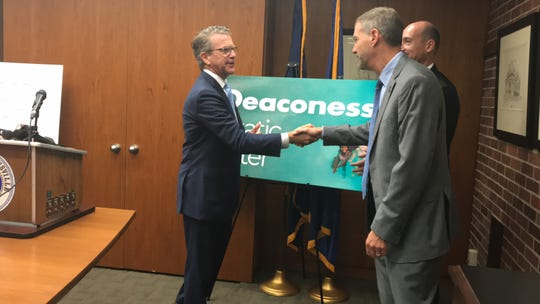 Mayor Lloyd Winnecke announced the 43-year-old pool's new name today — Deaconess Aquatic Center.