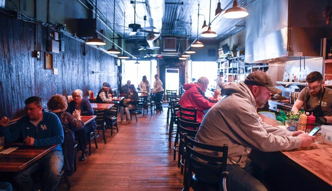 Henderson's historic Metzger's Tavern where generations have trod it's worn limestone steps, has reopened under new management and a smoke-free atmosphere Thursday. Aside from it's shiny clean face, the century old tavern has retained it's menu and charm, Wednesday April 4, 2018.