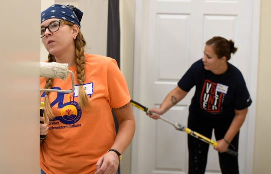 Julia Hardy, left, with Homes by Huffman and Kelly Bates with Vectren paint wall at the Aurora homeless shelter for the United Way Day of Caring, where hundreds of volunteers spend the day working at local nonprofit agencies to kick off the annual United Way fall campaign Friday, September 7, 2018.
