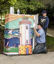 John Papenheim and Chad U'Ren of Papenheim SignCrafters in Fond du Lac install a wrap Friday, Sept. 7, 2018, around a utility box in downtown Fond du Lac. Doug Raflik/USA TODAY NETWORK-Wisconsin